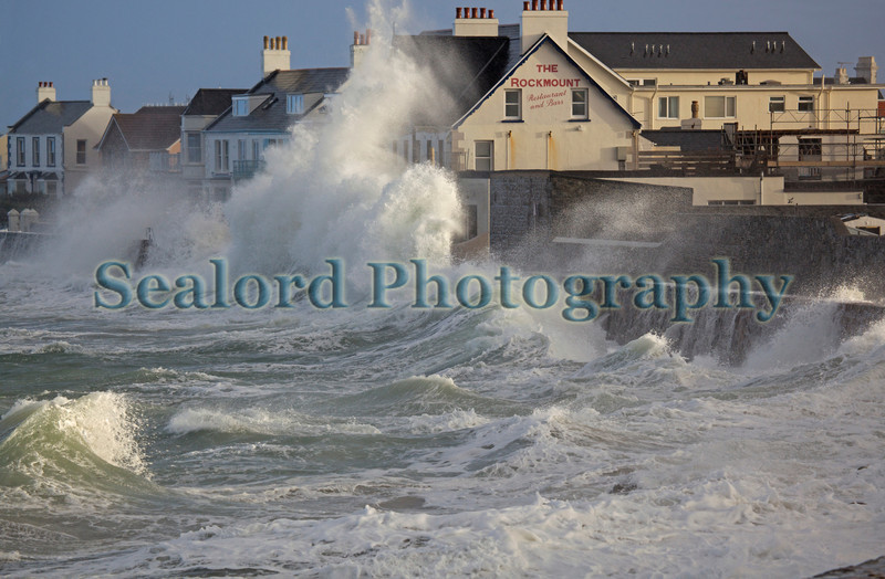 The Rockmount on Cobo Bay receives a wave