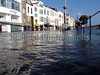 This image shows the flooded St Peter Port, Guernsey waterfront during the morning high spring tide of 10 March 2008.  High water was meant to reach 9.8 metres at 0815 but because the barometric pressure was only 973 mb Hg according to the Guernsey weather website the tide actually reached a height of 10.7 metres according to St. Peter Port harbour master Captain Peter Gill. This image was taken 27 minutes after high water as the tide was already receding. High water completely flooded the coast road, which was closed to vehicles for about one hour although several bicycles did manage to cycle through.<br /> <br /> File No. 100308 3561<br /> ©RLLord<br /> fishinfo@guernsey.net