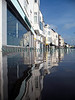 This image shows the St. Peter Port waterfront buildings reflected in the sea that rose to cover the coast road during the early morning high tide of 10 March 2008.  High tide was forecast for 0815 at 9.8 metres.  I photographed Havelet Bay during high tide and didn't arrive at the St. Peter Port waterfront until about half an hour after high water when the tide had already receded.  The waterfront road was closed to traffic because cars driving through the sea had produced waves that entered some waterfront properties.  The road remained closed for about one hour.  Because of the low barometric pressure of about 973 mb Hg the high spring tide rose to a height of 10.7 metres according to St. Peter Port's harbour master, Captain Peter Gill.<br /> File No. 100308 3579<br /> ©RLLord<br /> fishinfo@guernsey.net