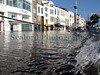 This image shows the St. Peter Port, Guernsey waterfront 27 minutes after high water on 10 March 2008.  The high tide was already receding.  High water was forecast for 9.8 metres at 0815 but because the barometric pressure had fallen to 973 mb Hg the tide rose to 10.7 metres according to the St. Peter Port harbour master, Captain Peter Gill. The wind was from the south-west and as St. Peter Port is on the east coast it was sheltered from the strong winds.  The high tide closed the waterfront main road to vehicles for about one hour.<br /> File No. 100308 3562<br /> ©RLLord<br /> fishinfo@guernsey.net