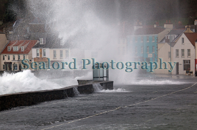 Storm driven wave crashes over sea wall along St Georges Esplanade, St Peter Port