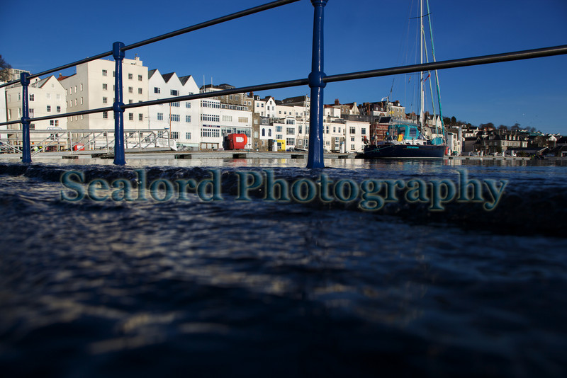 High spring tide overflows the Victoria marina, St Peter Port harbour