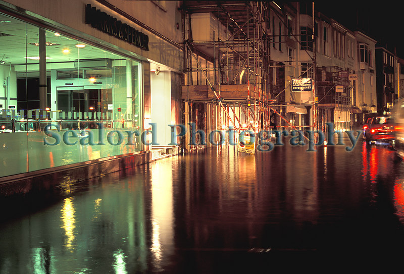 The St. Peter Port waterfront is flooded by the high tide of 10.2 metres at 2030 on 8 October 2006.  The Marks & Spencer shop received some seawater.<br /> File No. 28-865<br /> ©RLLord<br /> fishinfo@guernsey.net