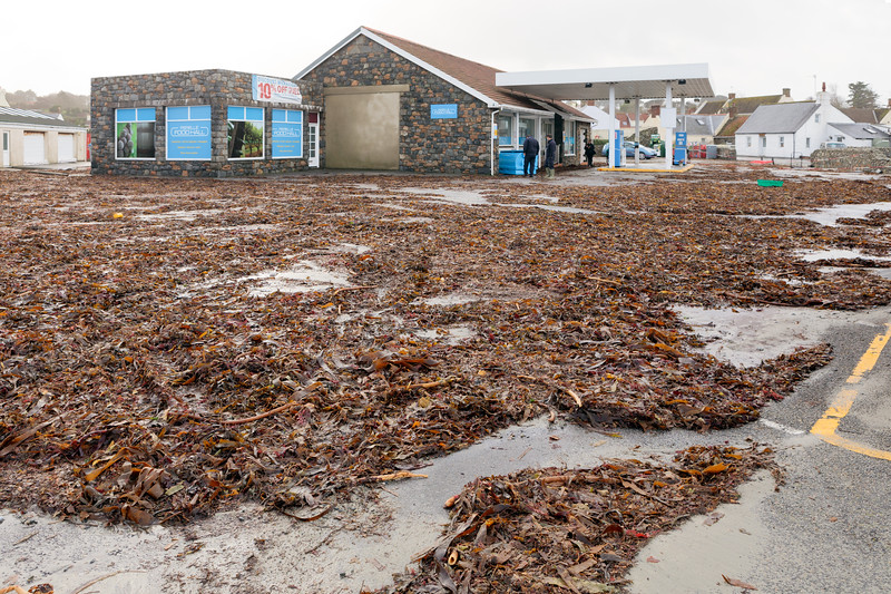 Perelle Food Hall and garage forecourt covered in seaweed from storm Eleanor