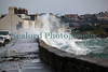 High spring tide waves overtop sea wall at Les Banques, Guernsey