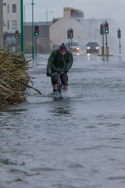 bicyclist cycling through flood St Georges Esplanade v 030214 ©RLLord 9214 smg