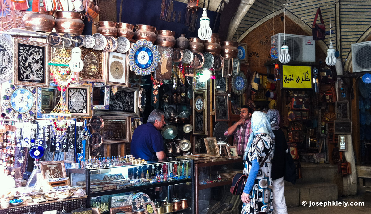 People shopping at a bazaar shop in Isfahan Iran