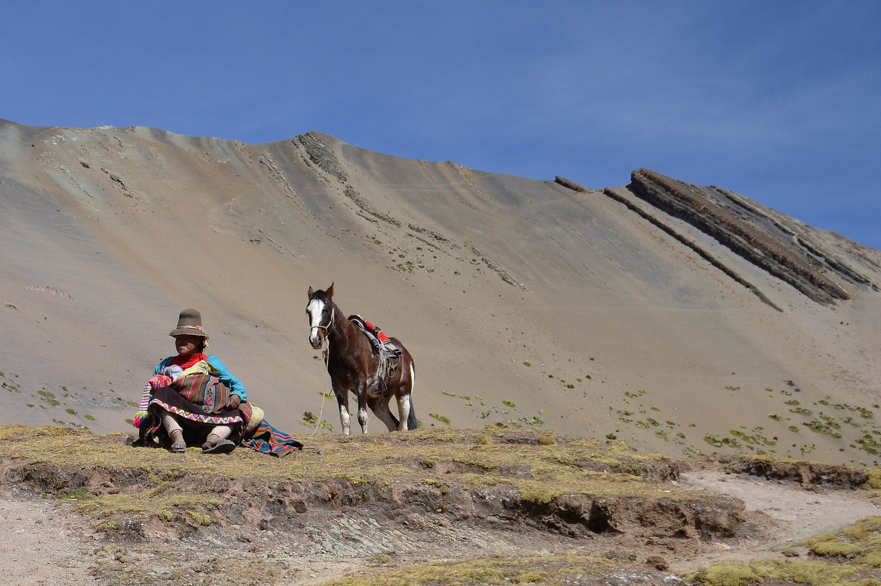 Rainbow Mountain Peru man with horse