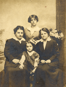 """About 1914 Philadelphia, PA  Edith May Marie (Johnson) Keating on left, daughter Elizabeth (Keating) Wiilliams, center front. Caption reads """"Mother, Aunt Laura, Aunt Adda, Elizabeth"""". (Courtesy of David R. Keating, Jr.)"""