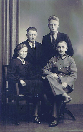 Undated, early 1940's Neu St. Jurgen, Germany Johann Kück, Sr. with his wife Meta (Monsees) Kuck and sons, Johann and Hinrich.