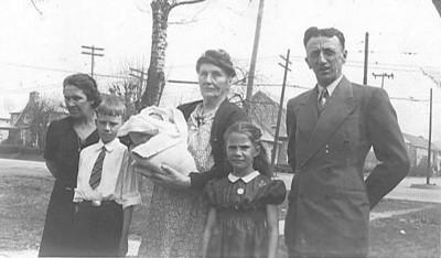 "Undated FAR LEFT - Lucy A. (Keating) Crosley; FAR RIGHT William J. Crosely. Original caption reads: ""grandparents, grandmother jones joe teresa baby gracie""."