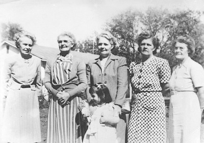 """November, 1947 Keatings sisters, five of the fourteen children of Leah K. (Brightenstine) and Thomas J. Keating. This photo was sent to Lucy (Keating) Crosley.  LEFT TO RIGHT - Helena """"Lena"""" (Keating) Williams, Mary (Keating) Kellar, Judy (child), Katherine """"Kitty"""" (Keating) Reaver, Susan """"Sue"""" (Keating) Undercuffler, and Alice V. Keating."""