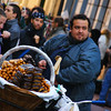 A man selling delicious churros and donuts to delight of a large crowd - Buenos Aires, Argentina.