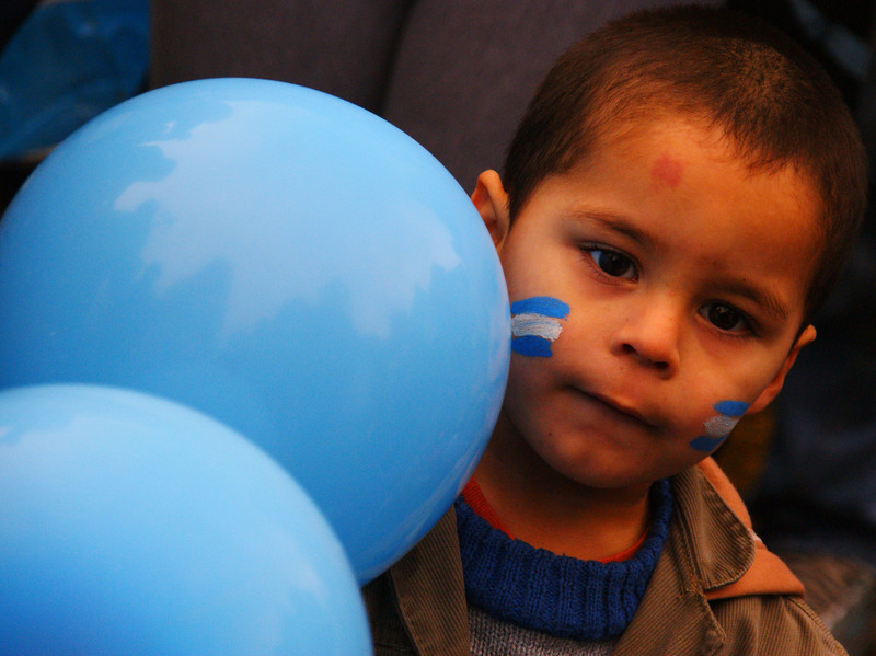 A cute boy cheering on the national squad - Buenos Aires, Argentina.