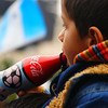 A boy enjoying a coke during the football match - Buenos Aires, Argentina.