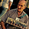 A man selling trinkets on tourists - Buenos Aires, Argentina.