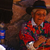 A lady enthusiastically making handicrafts - Norte Argentino