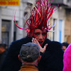 A man dressed in drag whispering something - Buenos Aires, Argentina.