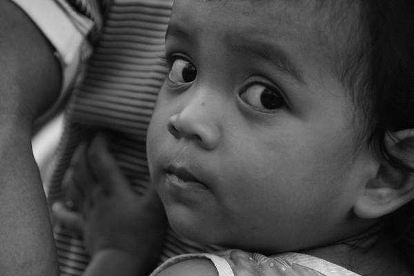 A close-up cropped shot of shy little girl - Battambang, Cambodia.