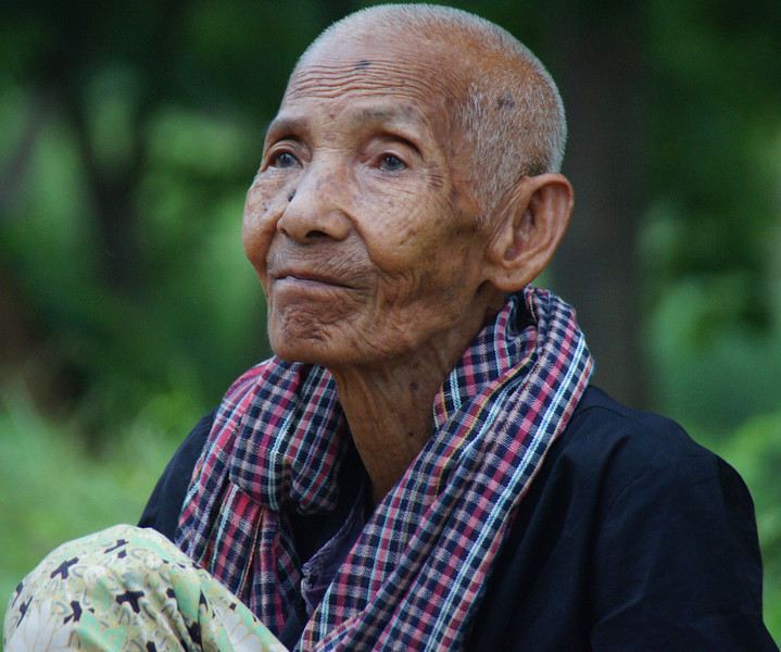 This elderly lady shows signs of character on her face and interesting life well lived - Battambang, Cambodia.