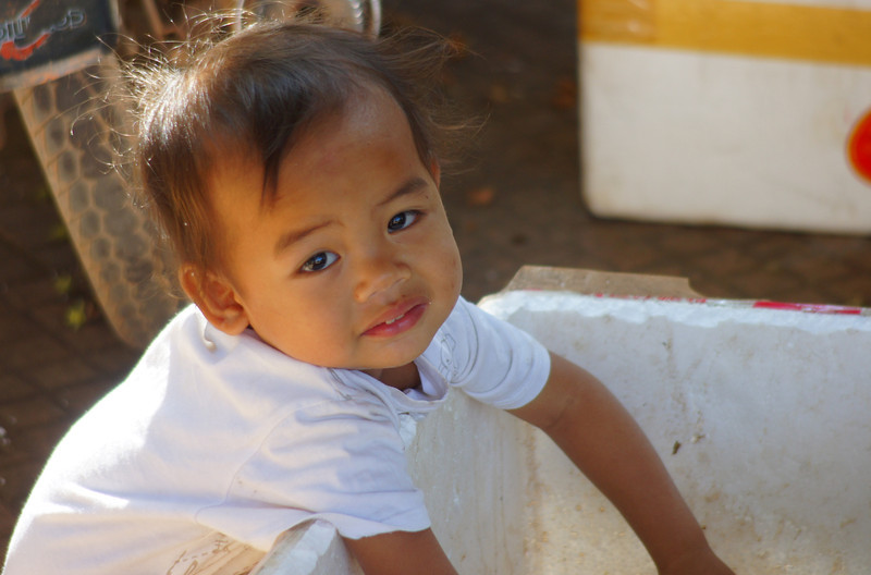 This cute girl washes her hands prior to eating lunch - Siem Reap, Cambodia.