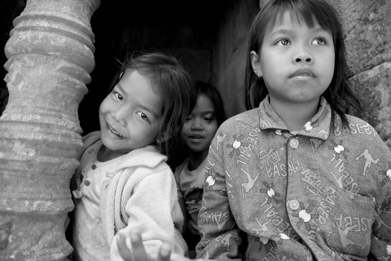 These cute kids were just hanging out and playing around the Temples of Angkor - Cambodia.