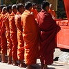 A group of monks stand still during their morning Alms Giving routine in Battambang, Cambaodia.
