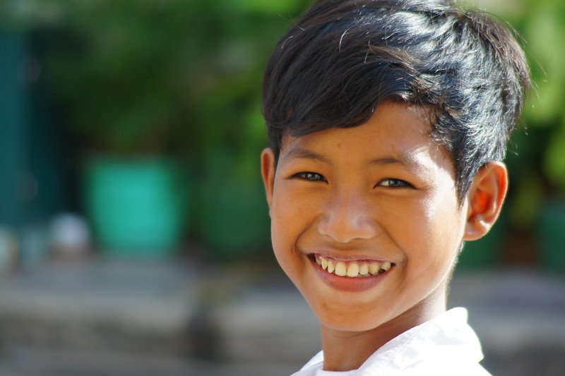 A charming Cambodian boy with a distinct faces flashes this most authentic smile on the streets of Battambang, Cambodia.