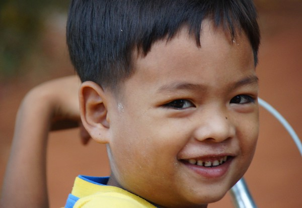 This boy has a wonderful authentic smile. He stopped to smile for me on his bicycle - Siem Reap, Cambodia.