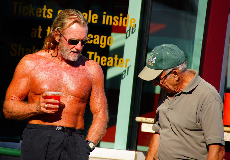 These two men are enjoying a conversation on a hot summer day.
