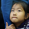 "<a href=""http://nomadicsamuel.com"">http://nomadicsamuel.com</a> : A cute Korean girl grasps ahold of her mother's arm at a subway station stop in Seoul, South Korea."