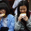 """<a href=""""http://nomadicsamuel.com"""">http://nomadicsamuel.com</a> : Two Korean students enjoy a street side snack along the bustling Insadong district area - one of the most popular tourist destinations in all of Seoul, South Korea."""
