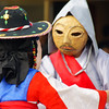 A candid action shot from a traditional Korean mask performance, in which a farmers ritual is taking place.