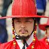 A Korean royal guard wearing traditional attire strikes a stoic pose prior to the border closing ceremonies at Gyeongbokgung Palace in Seoul, South Korea.