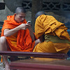 Monks either texting or playing games on their cell phone - Luang Prabang.