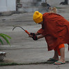 A monk at work - Luang Prabang.