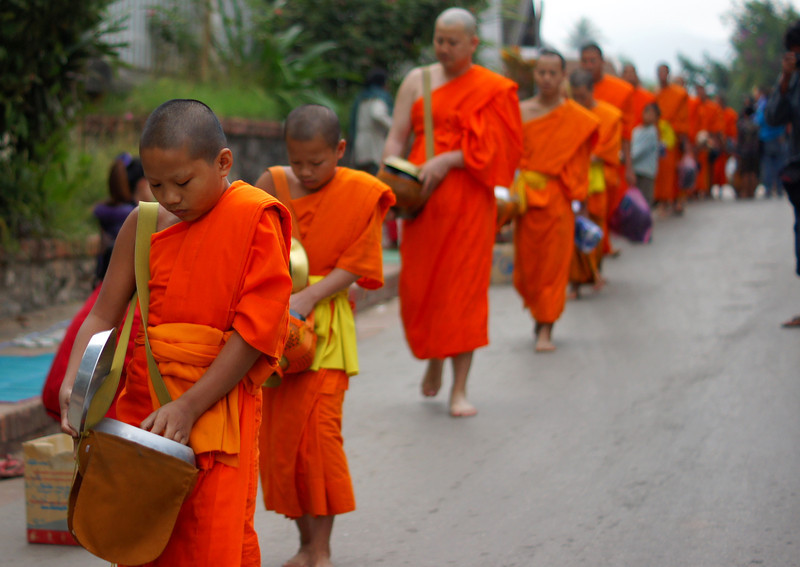 Almsgiving is a daily ritual not to be missed in Luang Prabang, Laos.  Locals and tourists alike take time to participate with the Laos monks.