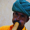 A snake charmer plays his musical instrument - Jaipur, India.