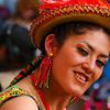 A sassy Senorita poses for the camera during the Fiesta del Gran Poder - La Paz, Bolivia.
