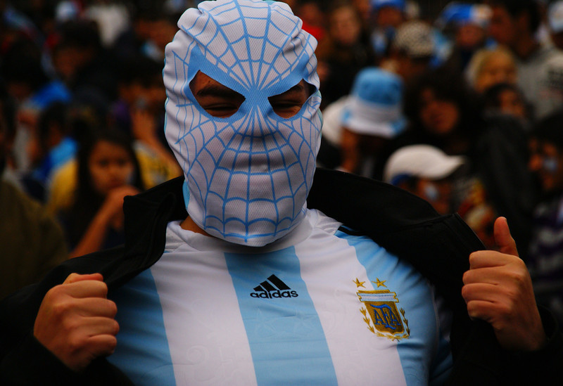 A man dressed up as the equivalent of Spider Man turned Argentine fan boldly poses for the camera - Buenos Aires, Argentina.