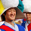 A Korean boy flashes an authentic smile as he performs for a large audience - Folk Village: Yongin, South Korea.