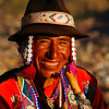 This smiling local plays guitar and flute while flashing off his infectious smile - Cuzco, Peru.