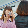 Korean lady putting on make-up waiting to catch the subway - South Korea