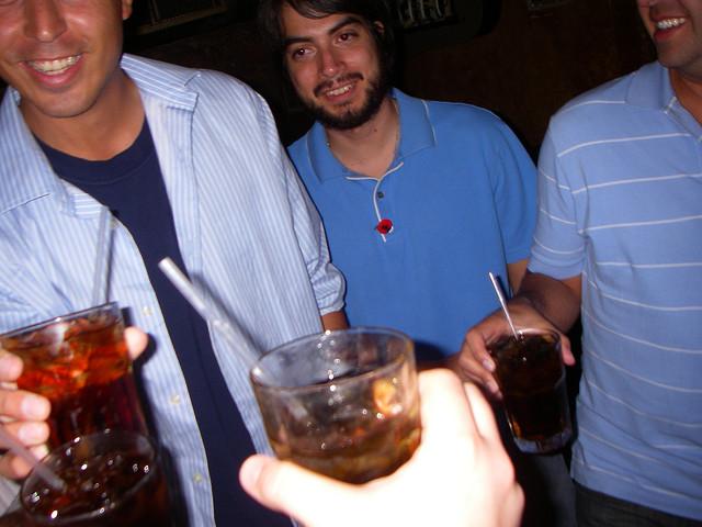 Friends celebrating in a party hostel.
