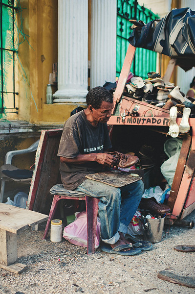 A shoe repairman hones his craft on the streets of Cartagena, Colombia