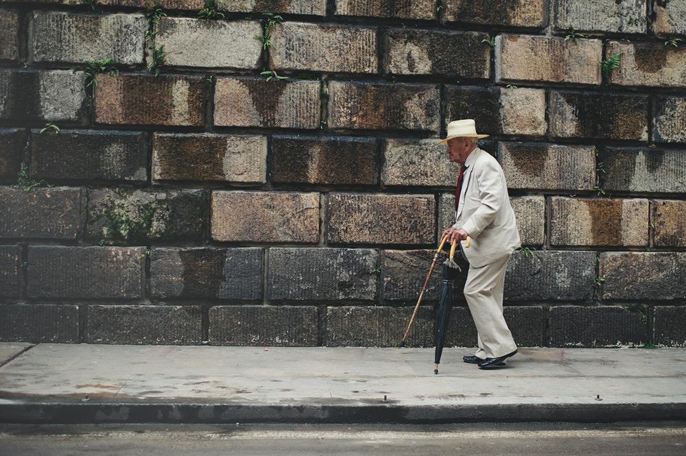 Old man walking in Bogota, Colombia