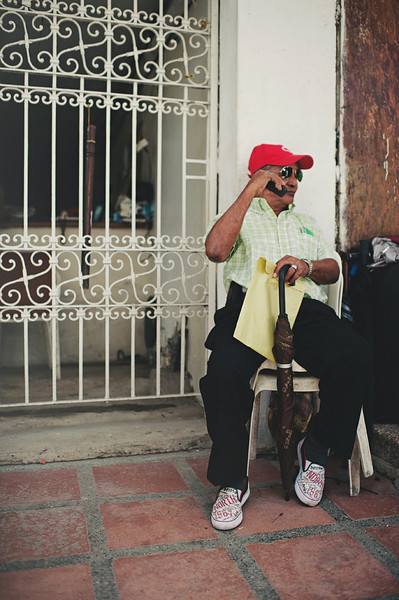 An elderly man on the phone in Cartagena, Colombia