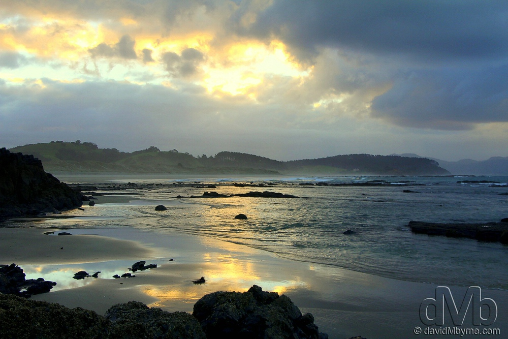 Sunset on a beach at remote Tawharanui Regional Park. April 27th 2012.