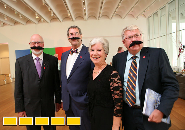 Bernard Riordon, from left, Douglas Stanley, Cassie Stanley and Dr. John McAvity begin the evening at The High Museum of Art for the Salvador Dali exhibit Monday, Aug. 2, 2010. The exhibit opens to the public on Saturday.  (Jenni Girtman)