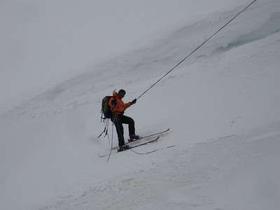 Rappeling in on skis